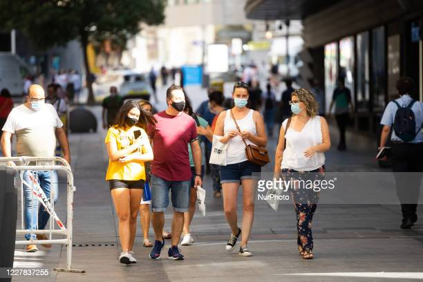 A group of people walk in the cherished street of Madrid Spain July 30 on the first day of the mandatory use of masks in the Community of Madrid