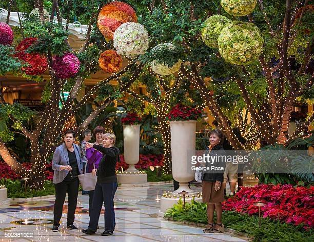 """Group of people walk through the holiday decorations at the Wynn Hotel & Casino on December 7, 2015 in Las Vegas, Nevada. Tourism in America's """"Sin..."""