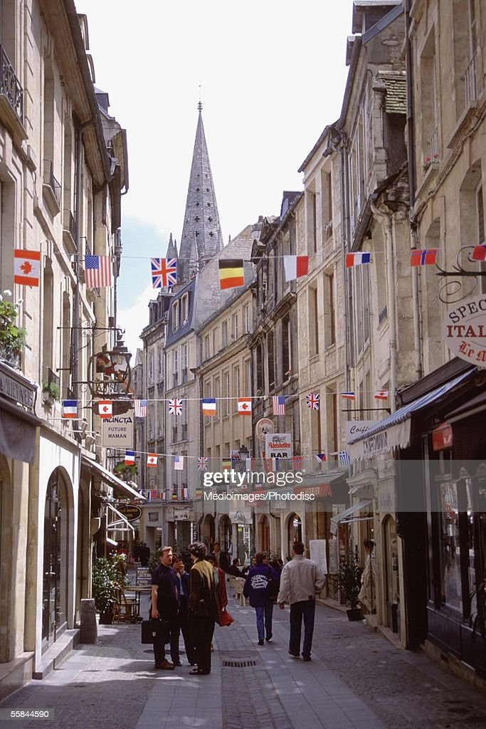 Group of people walking on a street, Caen, Normandy, France : Stock Photo