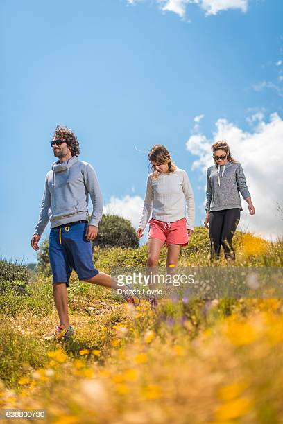 Group of people walking on hills in nature in springtime