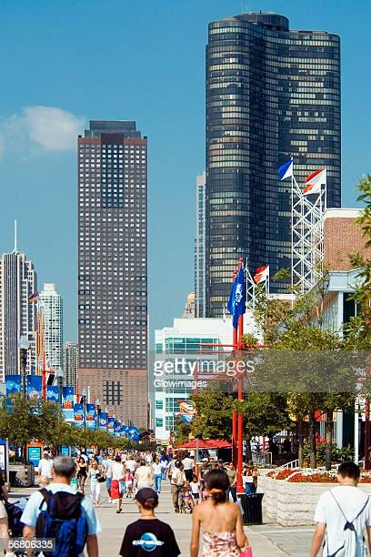 group of people walking on the pier, navy pier, chicago, illinois, usa - navy pier stock pictures, royalty-free photos & images