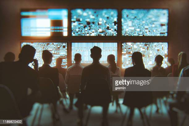 group of people watching multiple tv sets at the same time - crowd stock pictures, royalty-free photos & images