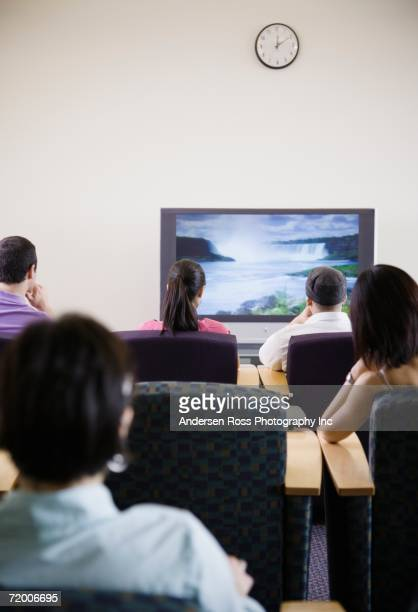 Group of people watching television