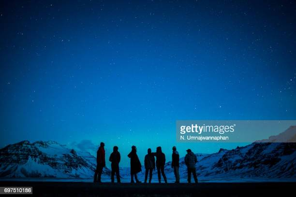A group of people watching the aurora in southern Iceland