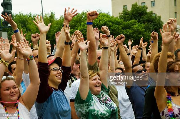 Group of people waving their arms in a gay parade