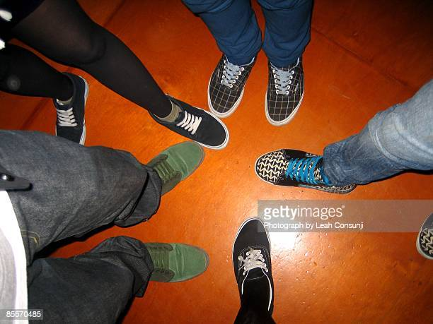 Group of people wearing footwear, low section