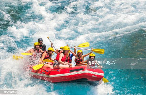 group of people white water rafting - rafting stock pictures, royalty-free photos & images