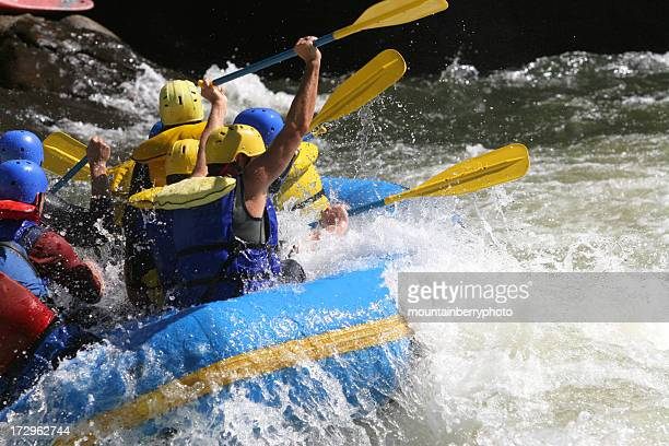 A group of people whitewater rafting