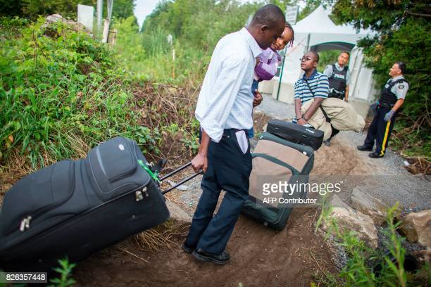 A group of people who claimed to be from Haiti cross the border into Canada illegally from Champlain New York on August 4 2017 Migrants have been...