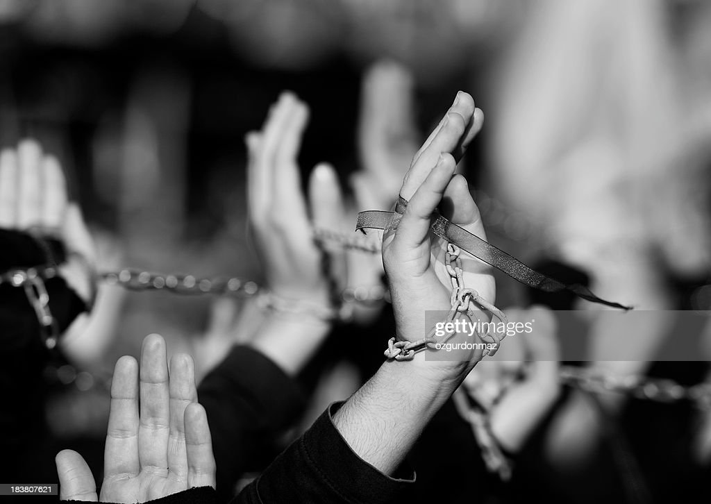 Group of people with arms raised : Stock Photo