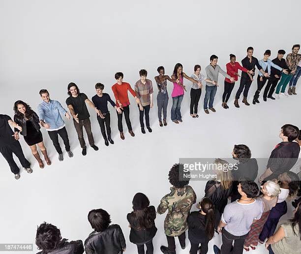 group of people with hands outstretched