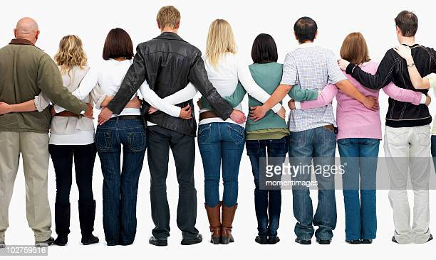Group of people with their arms around each other's backs