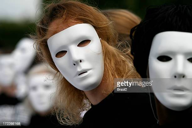Group of people with white masks looking into camera