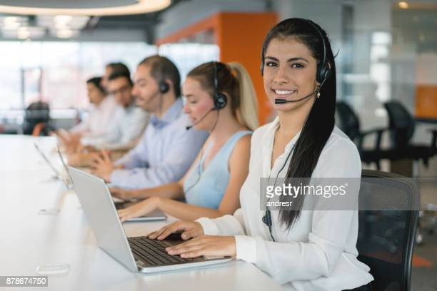 Group of people working at a call center and looking very happy
