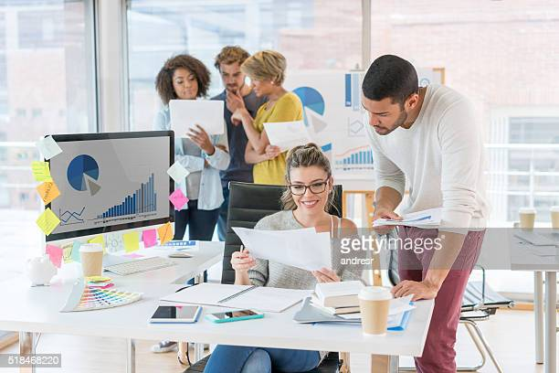 Group of people working at a creative office