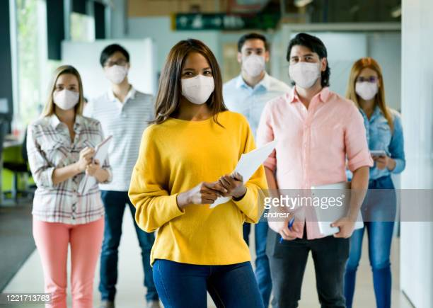 group of people working at a creative office wearing facemasks - avoidance stock pictures, royalty-free photos & images