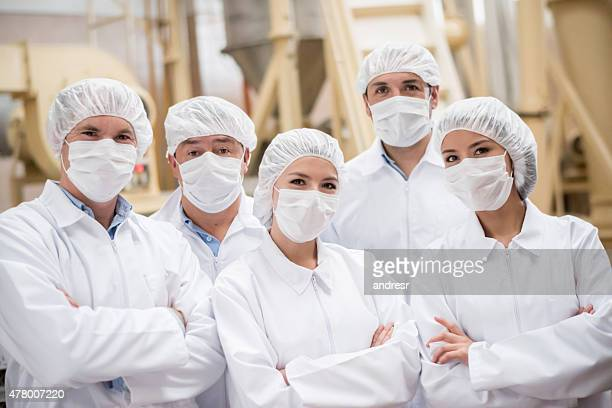 group of people working at a food factory - 食料倉庫 ストックフォトと画像