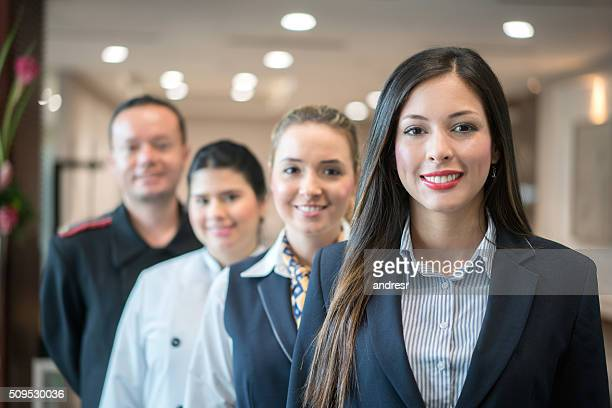 group of people working at the hotel - hotel stock-fotos und bilder