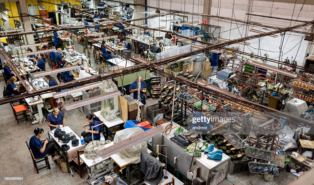 Group of people working in a factory : Stock Photo