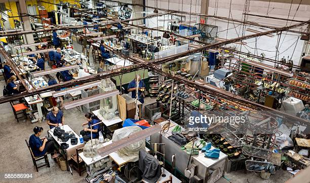 group of people working in a factory - calzature di pelle foto e immagini stock