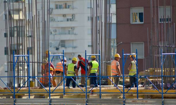 Group Of People Working In Front Of Building