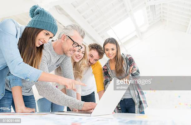 Group of people working online at a creative office