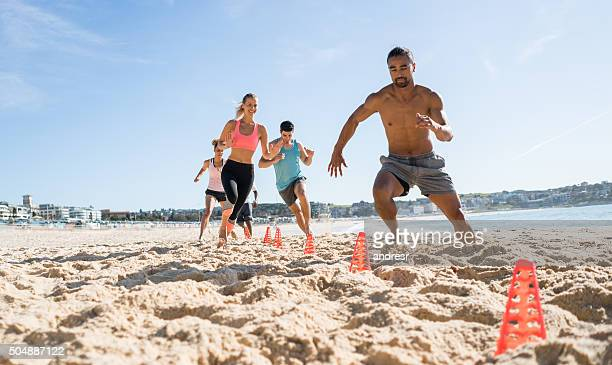 Group of people working out at the beach