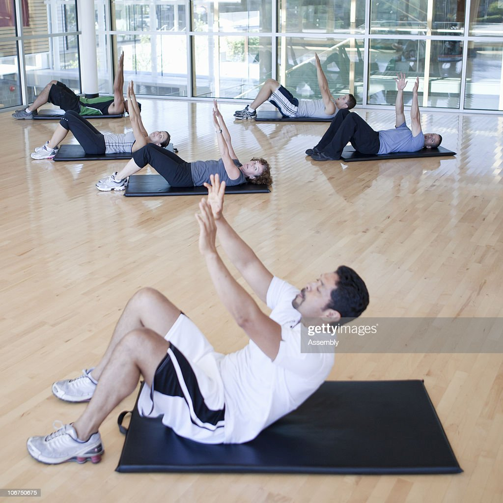 Working Out: Group Of People Working Out In A Fitness Class Stock Photo