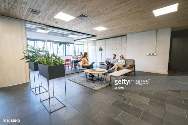 group of people working together at a co-working space - coworking stock photos and pictures