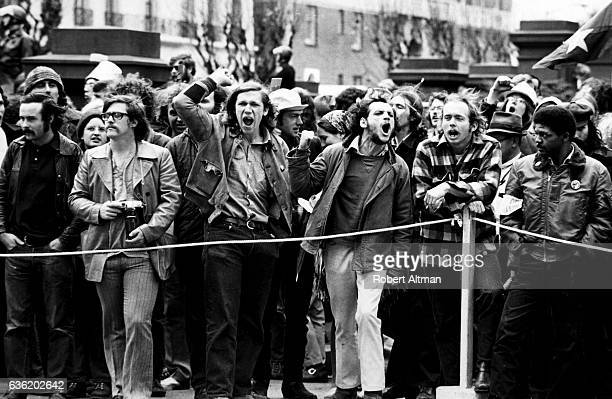 A group of people yell during an AntiWar Rally demonstration at the Fairmont Hotel circa 1973 in San Francisco California