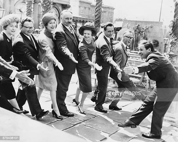 A group of performers and politicians dancing in unison during rehearsals for the charity show 'DDay With the Stars' Lady Alexander of Tunis Harry...
