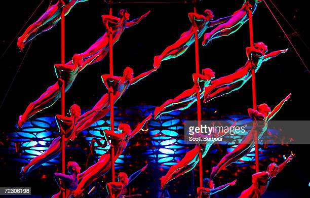 A group of performers hang from poles on stage during a dress rehearsal of Cirque du Soleil's Saltimbanco January 5 2003 in London United Kingdom...