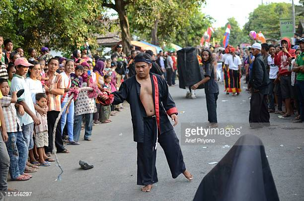 A group of performers in a traditional art performance known as Bantengan in Trowulan village Bantengan is a traditional Indonesian dance which...