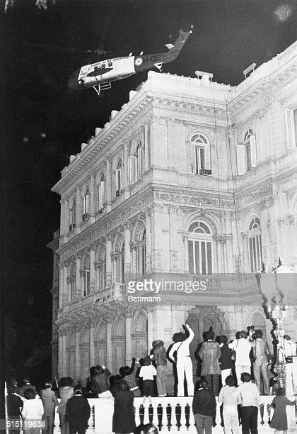A group of Peronistas on Plaza de Mayo waves as the helicopter carrying President Isabel Peron takes off from Casa Rosada the Argentine Government's...