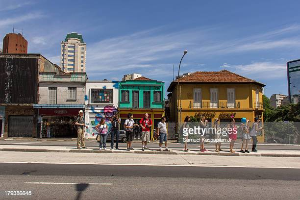 Group of photographers lined Avenida da Consolation, São Paulo, during a photographic output held on December 2, 2012.