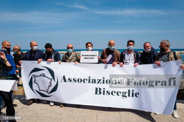 Group of photographers protest on the Lungomare in front of the Puglia Region on the first day in the orange zone for lack of support from the...