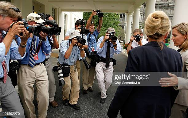 Group of photojournalists follow Arizona Governor Jan Brewer after she answered questions from members of the news media outside the West Wing at the...