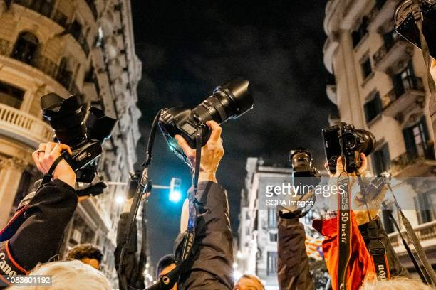 A group of photojournalists seen raising their cameras asking for the freedom of photojournalist Carlos Palacio arrested in Gerona during the protest...