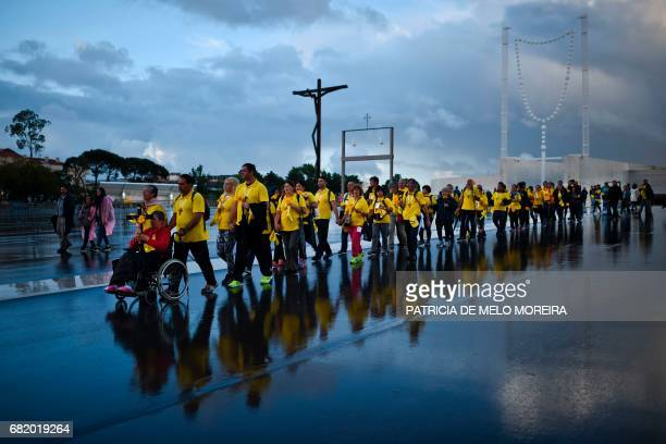 TOPSHOT A group of pilgrims arrive at Fatima Sanctuary in Fatima central Portugal on May 11 2017 Two of the three child shepherds who reported...