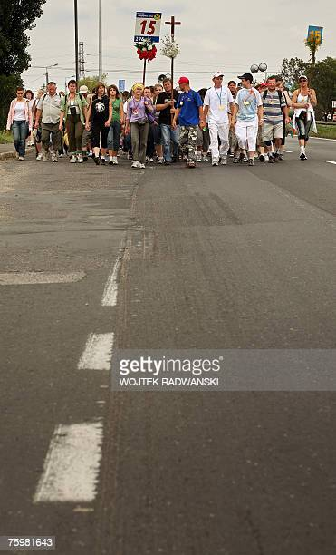 A group of pilgrims from Warsaw walks in a Warsaw suburb 06 August 2007 as they take part in an annual pilgrimage to the Jasna Gora monastery in...