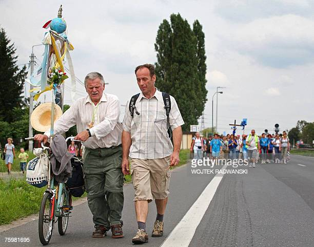 A group of pilgrims from Warsaw walks through a Warsaw suburb 06 August 2007 as they take part in an annual pilgrimage to the Jasna Gora monastery in...