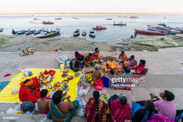 A group of pilgrims is performing a religious ritual at Pandey Ghat in the suburb Godowlia