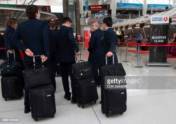 A group of pilots and flight attendants with Turkish Airlines wait to go to their plane on March 21 2017 at John F Kennedy International Airport in...
