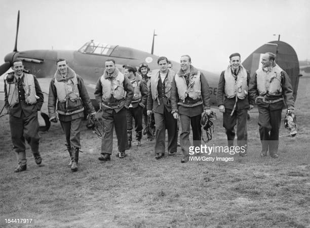 The 303 Polish Fighter Squadron In The Battle Of Britain A group of pilots of No 303 Polish Fighter Squadron RAF walking toward the camera from a...