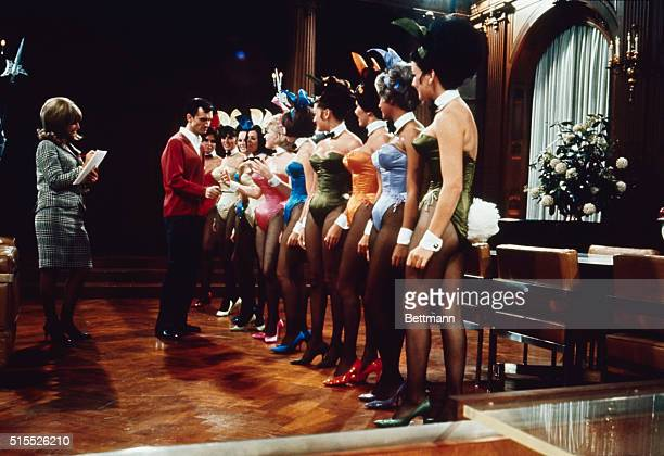 A group of Playboy Bunnies line up for inspection by Hugh Hefner publisher of Playboy magazine in the main room of Playboy Mansion in Chicago Hefner...