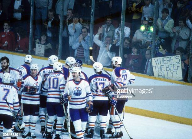 A group of players from the Edmonton Oilers celebrate after defeating the New York Islanders in the 1984 Stanley Cup Finals in May 1984 at the...