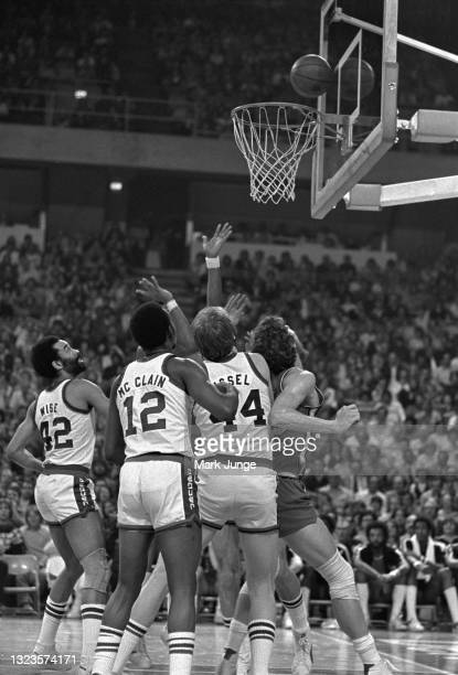 Group of players wait under the rim to grab a rebound during an NBA basketball game between the Portland Trail Blazers and the Denver Nuggets at...