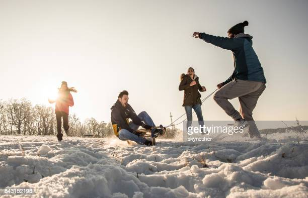 Group of playful people enjoying a day on the snow.