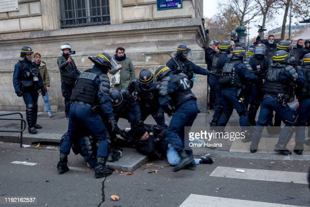 A group of police beat and arrest a demonstrator during the first day of an indefinite general strike on December 05 2019 in Paris France According...