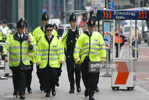 A group of police officers arrive at the Liverpool Street station in London after an explosion occured on the tube line 07 July 2005 Police said they...